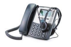 IP有在白色隔绝的耳机的电话设备 免版税库存照片