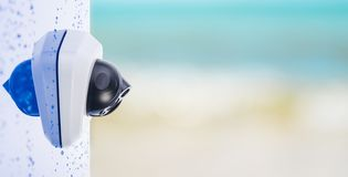 CCTV camera on the wet wall, beautiful blurry background with space for text. Concept - technology and security stock photography