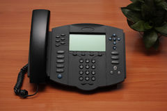 IP Phone. Modern IP Phone on a wooden desk Royalty Free Stock Images