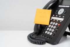 IP phone headset with calling back message on sticky note Royalty Free Stock Photography