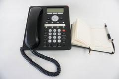 IP Phone and notebook. Isolated IP Phone and notebook Stock Images