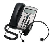 IP rufen und ein Kopfhörer an, der auf Weiß getrennt wird Lizenzfreie Stockfotos