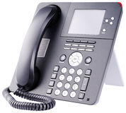 IP telephone on white. Office IP telephone set with LCD isolated on the white Royalty Free Stock Image