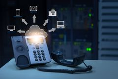 IP Telephony cloud pbx concept, telephone device with illustration icon of voip services. And networking data center on background stock photos