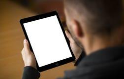 IPad空气2在手上 免版税库存图片