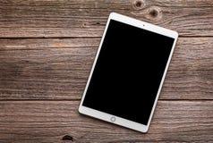 IPad赞成10 从苹果计算机公司的5英寸 在一张木表 库存图片