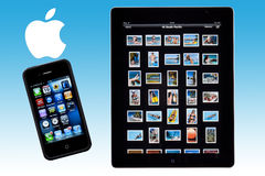 Ipad 2 - iphone 4S - Apple Logo. An Apple ipad 2 and iphone 4S with the Apple logo Stock Photos