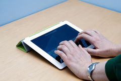 IPad 2 tablet user hands typing Royalty Free Stock Image
