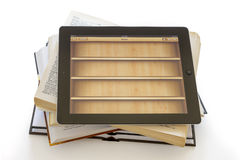 Ipad 3 with Books application on opened books Stock Photography