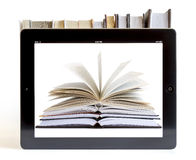 Ipad 3 with books background Royalty Free Stock Photos