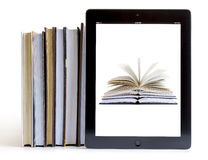 Ipad 3 with books background on books Stock Images