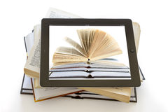 IPad 3 with books background on opened books Stock Image