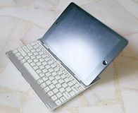 Ipad air on bluetooth keyboard Royalty Free Stock Image