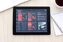 IPad with app Bloomberg is on the table Stock Images