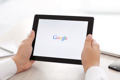 IPad with app Google in the hands of men Stock Image