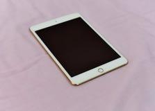 Ipad. Apple new ipad mini4 white And gold ipad Royalty Free Stock Photos