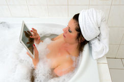 With iPad in bath Royalty Free Stock Photos