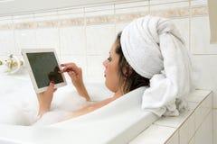 With iPad in bath Stock Photos
