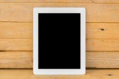Ipad branco no fundo de madeira marrom da tabela Fotos de Stock Royalty Free