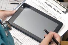 Ipad Chart. Intern uses Ipad to check patient chart Royalty Free Stock Photo