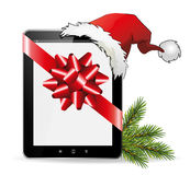 IPad Christmas Gift with Santa Hat Royalty Free Stock Images
