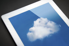 IPad with cloud -- cloud computing!. Sync to the cloud with your mobile device stock photos