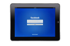 iPad d'Apple avec le facebook $$etAPP Images libres de droits