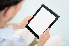 iPad de Apple de la explotación agrícola del hombre en manos Fotografía de archivo