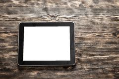 Ipad. Desk black tablet touch wooden table Royalty Free Stock Photography
