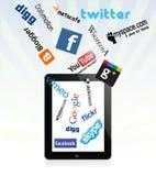 Ipad en sociale netwerkemblemen Stock Foto's