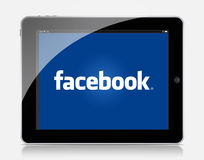 Ipad facebook. White Apple iPad 2 With Facebook Displayed On The Screen royalty free stock photo