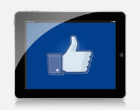 Ipad facebook. White Apple iPad 2 With Facebook Displayed On The Screen Royalty Free Stock Photography