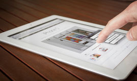Ipad finger touch. Someone touches the screen, the iPad Stock Photography