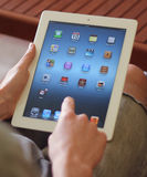Ipad on hand. The person holding the iPad, and switches on the screen Royalty Free Stock Photo