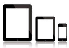 iPad, iPad mini e iPhone Imágenes de archivo libres de regalías
