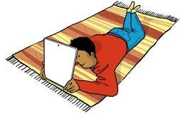 Ipad magic carpet. Young man watching an ipad lying on a carpet Stock Illustration