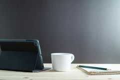 IPad-mini and coffee  on wooden desk. Stock Photography