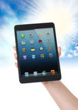 Ipad mini on hand-clipping path Royalty Free Stock Image