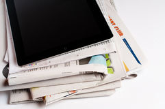 IPad with newspapers. A stack of newspapers with an iPad on the top Royalty Free Stock Photos