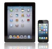 iPad novo 3 de Apple e iPhone 5 Fotografia de Stock
