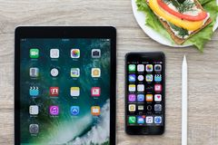 IPad Pro and iPhone with home screen in the table Stock Images