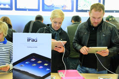IPad on Sale. This was shot at the Apple Store at the Fifth Avenue of Manhattan, New York City on April 4, 2010.   People are swarming into the store to try Royalty Free Stock Images