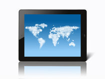 Ipad with world map made of clouds on screen Stock Images