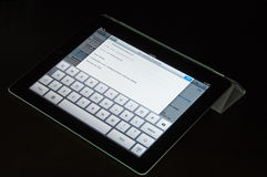 IPad2 with Smart Cover is used to compose an eMail Royalty Free Stock Photos