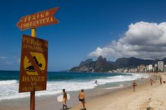 Ipanema Beach. Signpost - Danger to swiming royalty free stock image