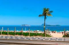Ipanema beach with mosaic of sidewalk in Rio de Janeiro Stock Photo