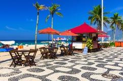 Ipanema beach with mosaic of sidewalk in Rio de Janeiro Royalty Free Stock Image