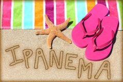Ipanema beach vacation concept - sand and towel Stock Photography