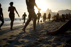 Ipanema strand Rio de Janeiro Brazil Sunset Silhouettes Royaltyfria Foton