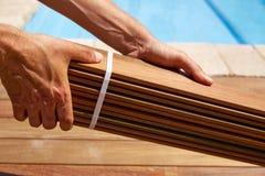 Ipe deck installation carpenter hands holding wood Stock Images